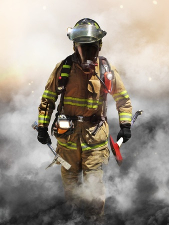 Fireman walking out of smoke